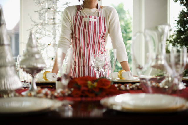 Woman Standing by Table Decorated for Christmas